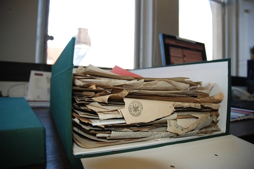 A box of vintage newspapers in the herbarium
